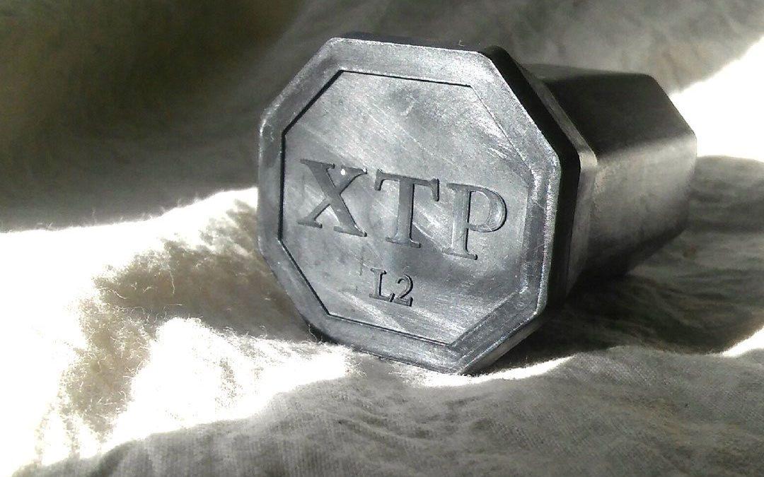 UNITED STATES RACQUET STRINGERS ASSOCIATION & XTP Butt cap.
